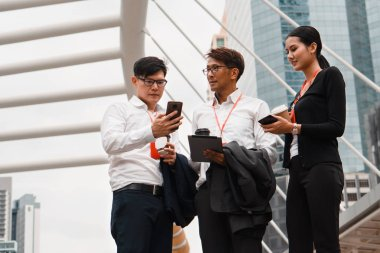 asian business people with tablet and smartphone on hands standi