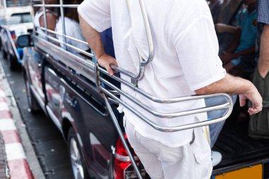 passengers in thai tuk tuk