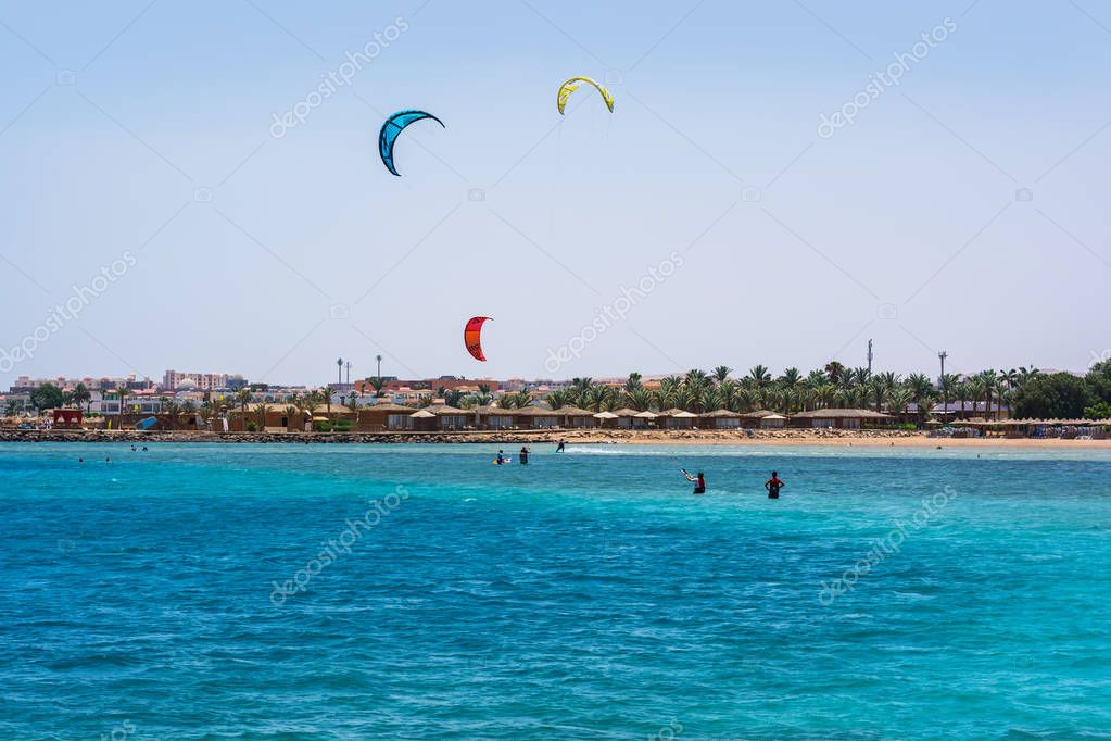 Editorial. June, 2018. Kitesurfing, young people having fun at sea