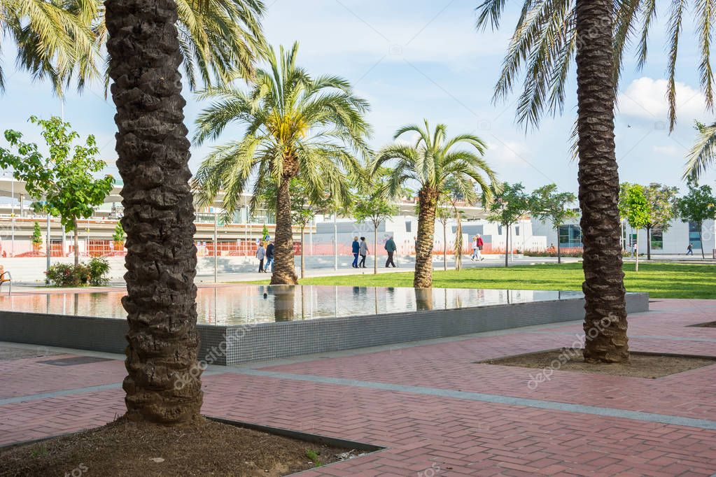 Editorial. May, 2018. Girona, Spain. Park with palm trees near the railway station in Girona, Spain.