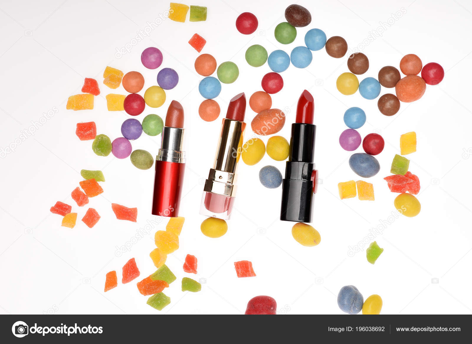Red lipsticks, sweets, dragee, candy, candied fruit, confetti