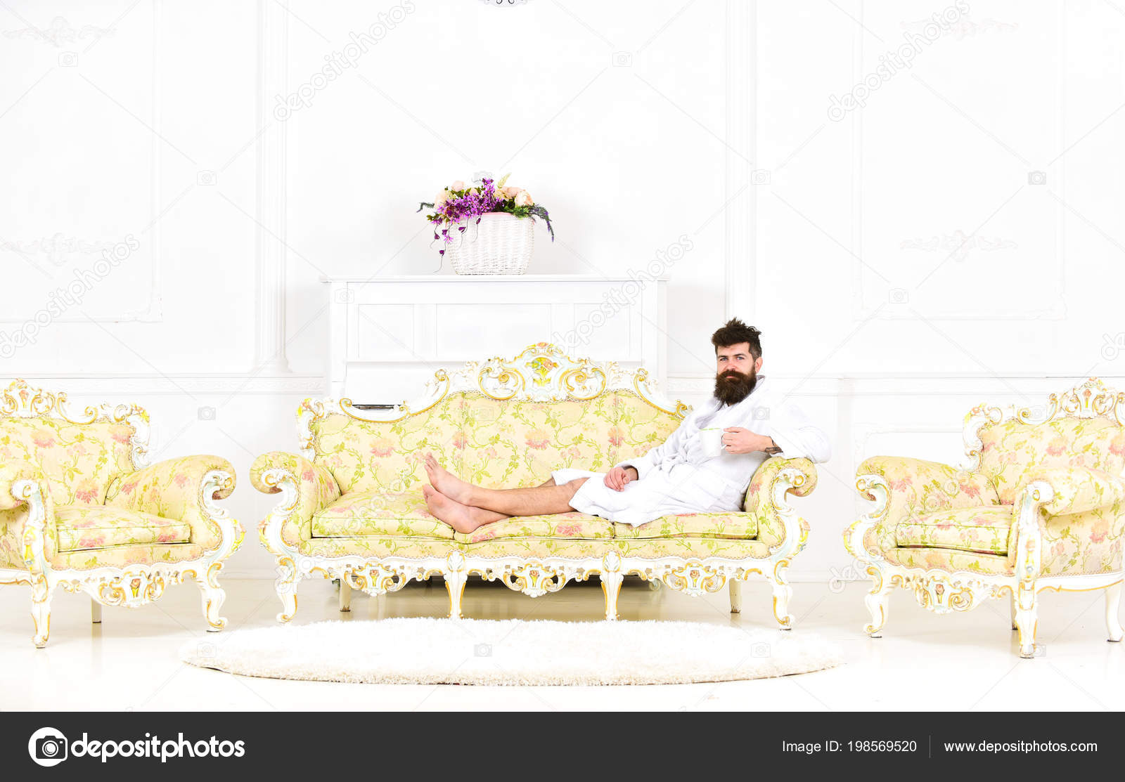 Luxury Life Concept. Man With Beard And Mustache Enjoys Morning While  Sitting On Old Fashioned Luxury Sofa.