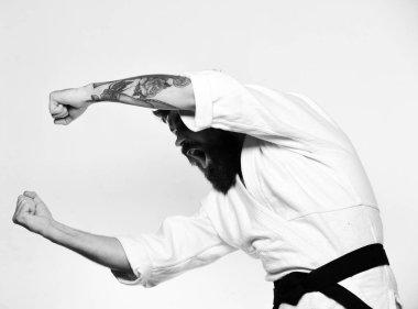 karate blow. Karate man with busy face in uniform. Jiu Jitsu master