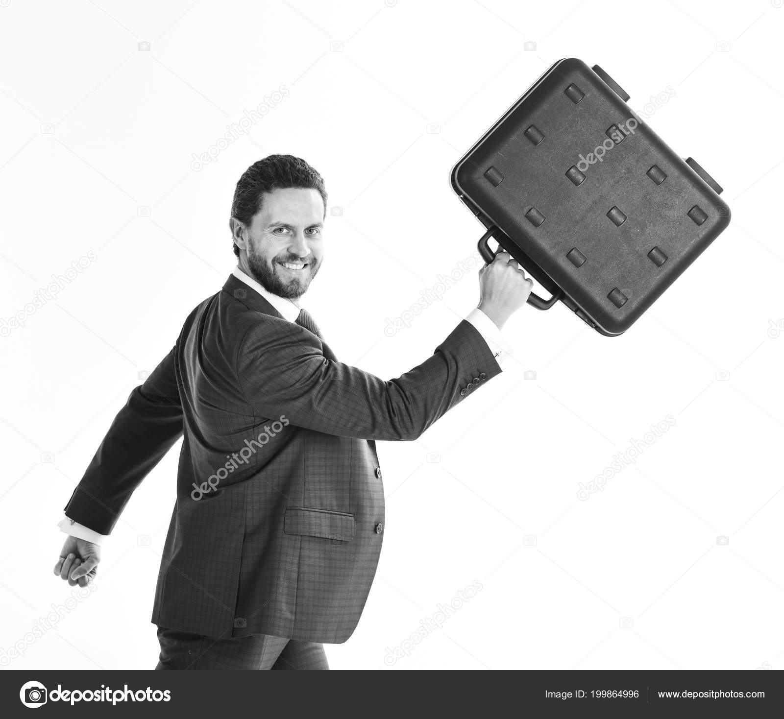 Businessman with smiling face in motion forward man in blue formal suit holds black case and walks business and success concept
