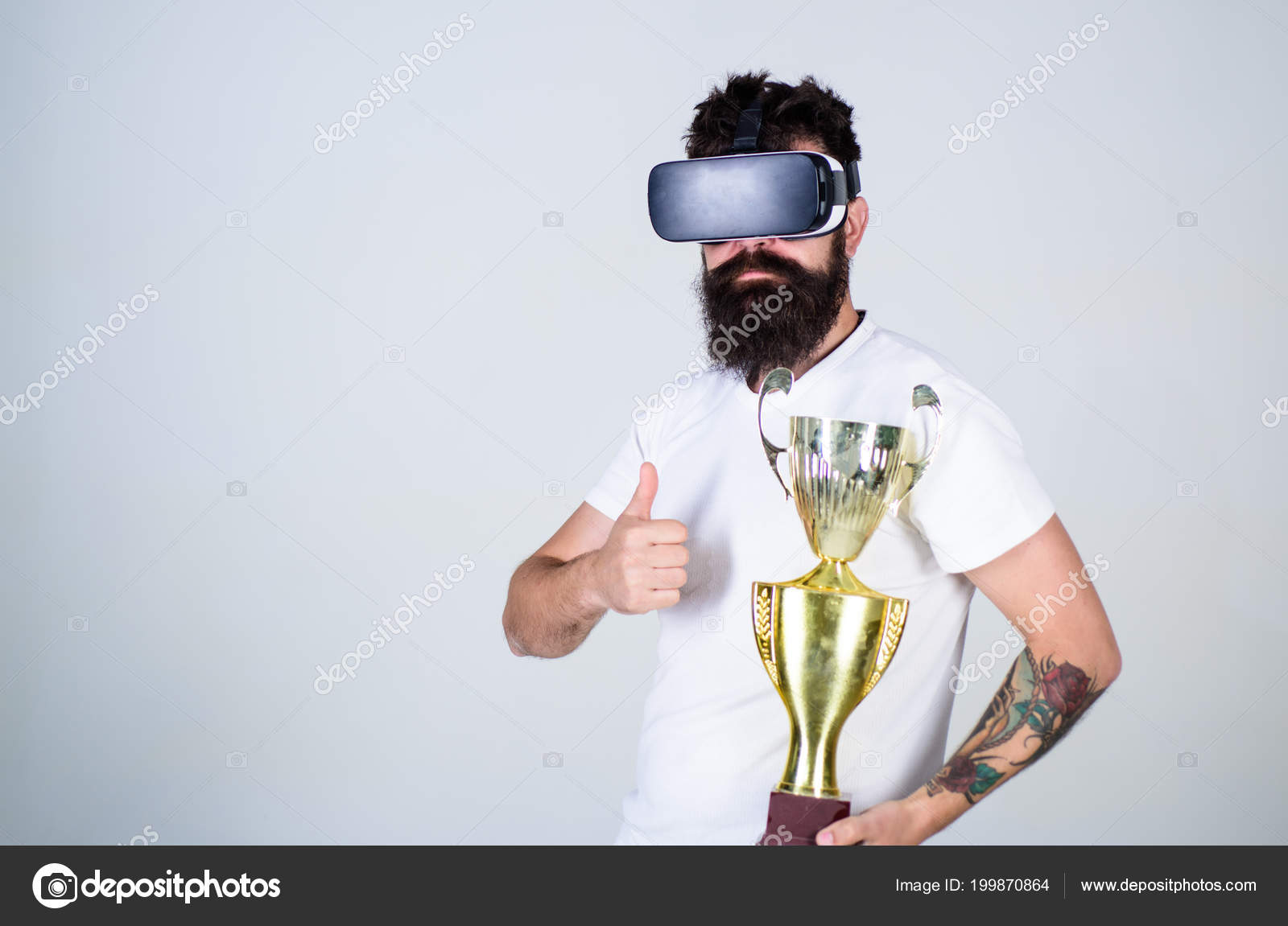 Man with beard in VR glasses, grey background  Hipster on