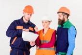 Fotografie Builders and engineer arguing, misunderstanding. Team of architects, engineers