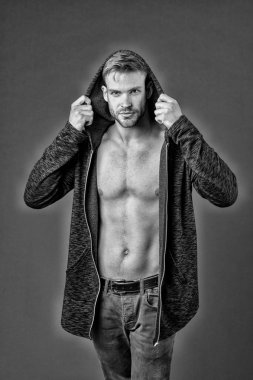 Fit man put on hoodie. Sexy macho enjoy casual style. He got perfect torso. Muscular body of sexy man. Diet. Masculinity and charisma. Fitness and wellness, black and white