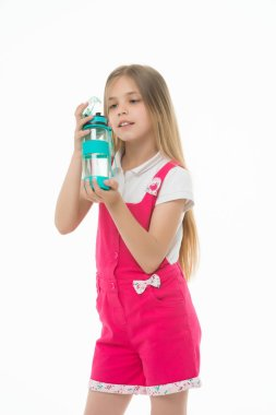 Girl hold water bottle isolated on white. Little child with plastic bottle. Only clean and fresh water. Thirst and health. Childhood. Stay hydrated and healthy. Drinking water for health