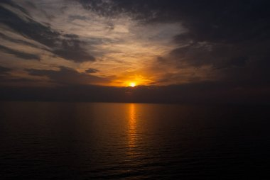 Sunset in sea on dramatic sky with clouds. transience of life. Seascape in evening dusk. Next day will be better. Sunrise view. Meeting sunset on sea. Nature and environment. Vacation and wanderlust