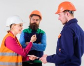 Fotografie Builders and engineer arguing, misunderstanding. Labor dispute concept.