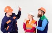 Fotografie Labor dispute concept. Men in hard hats and uniform