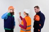 Fotografie Labor dispute concept. Builders and engineer arguing, misunderstanding.