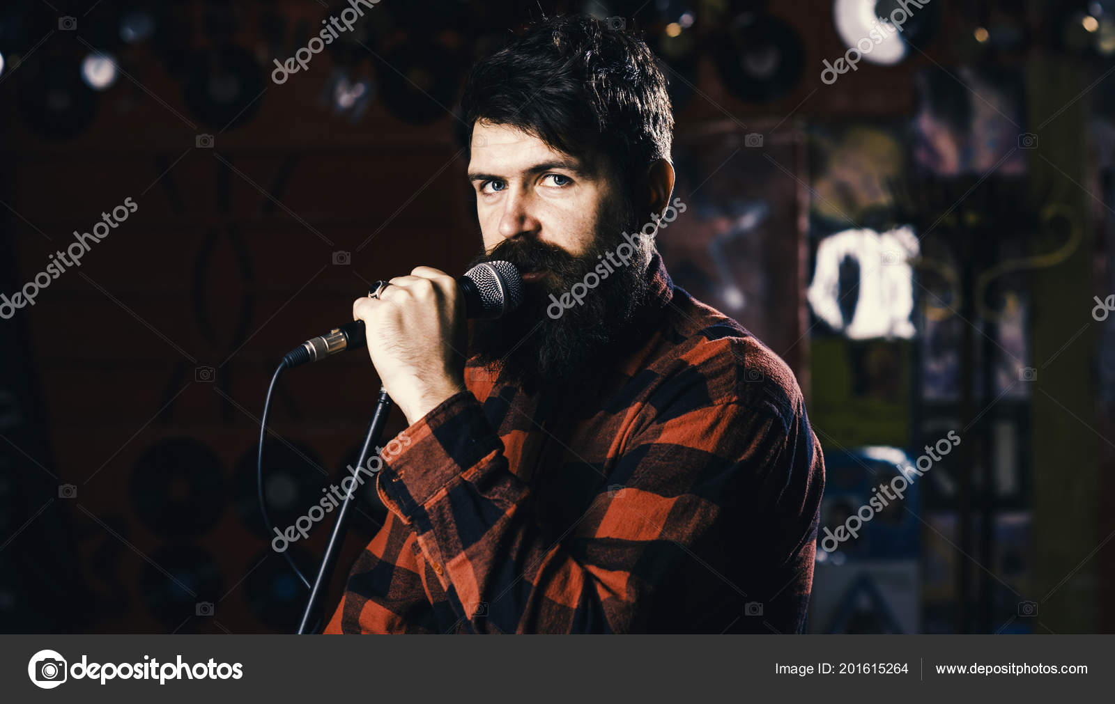 Musician with beard and mustache singing song in karaoke  Hipster