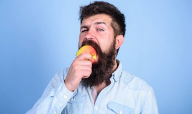 I love apples Man handsome hipster with long beard eating apple. Hipster hungry bites juicy ripe apple. Fruit healthy snack always good idea. Man diet nutrition eats fruit. Healthy nutrition concept