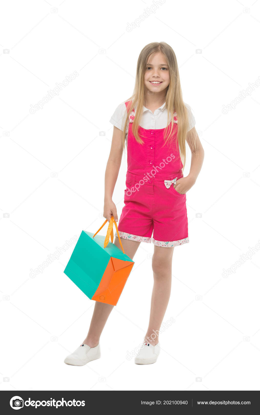 6898e8804d9 Kids designer clothing summer sale. Girl cute teenager carries shopping  bag. Kid bought clothing