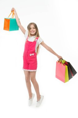 Top tips for smart kid clothes shopping. Girl cute teenager carries shopping bag. Kid bought clothing summer sale. Loyalty benefits. Why customers participate in loyalty programs