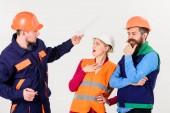 Fotografie Labor dispute concept. Builders and engineer arguing,