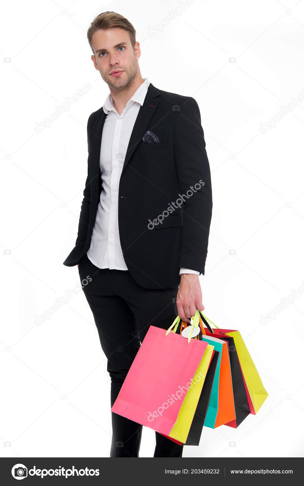 64eac73deab Человек стилист профессиональных покупателей. Магазин консультант помогает  несет кучу сумок. Консультант одежды. Стилист