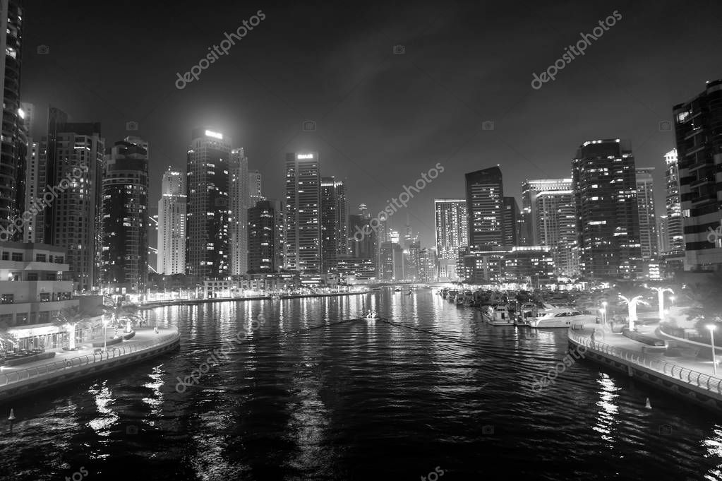 Dubai, United Arab Emirates - December 26, 2017: water canal on Dubai Marina skyline at night. Residential towers with lighting. Architecture or structure and design. Vacation and wanderlust