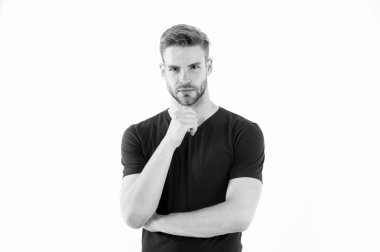 Bearded man touch beard with hand. Man with stylish hair and healthy young skin. Guy with unshaven face and mustache. Beard grooming and hair care in barbershop. Skincare and mens beauty concept