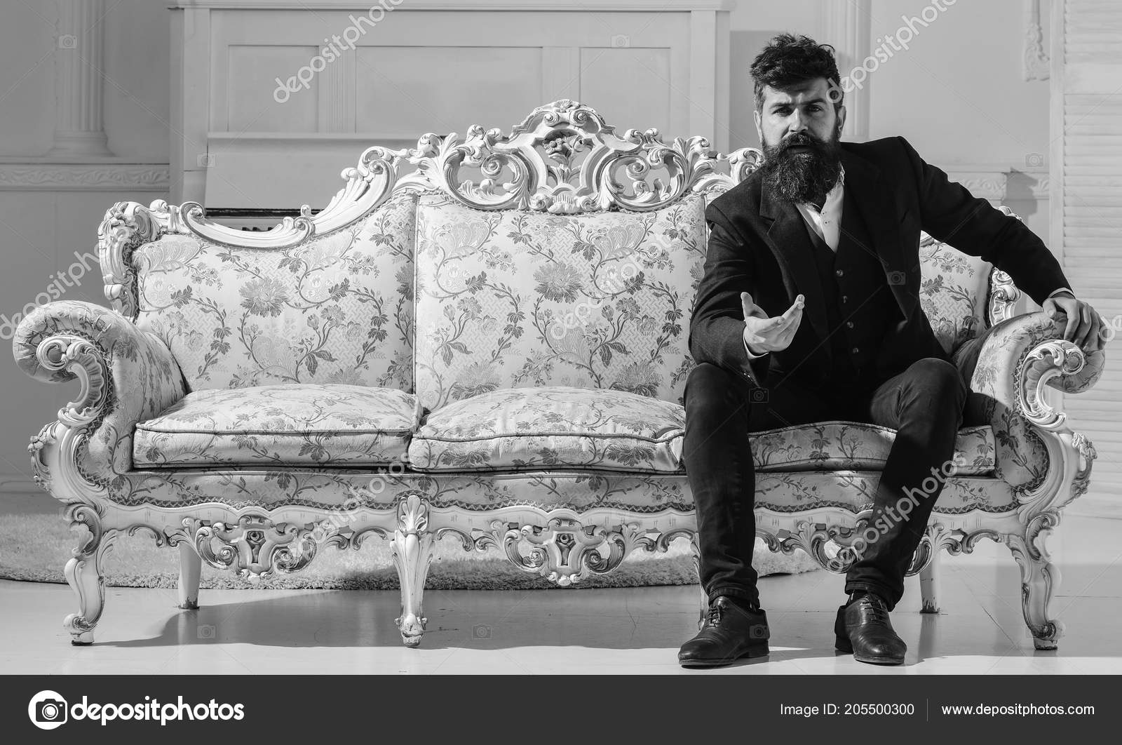 Fashion And Style Concept. Man With Beard And Mustache Wearing Fashionable  Classic Suit, Sits On Old Fashioned Couch Or Sofa U2014 Photo ...