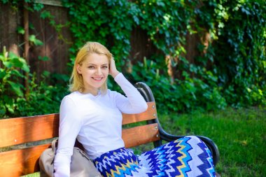 Time for yourself. Woman blonde take break relaxing in park. Girl sit bench relaxing in shadow, green nature background. Why you deserve break. Ways to give yourself break and enjoy leisure.
