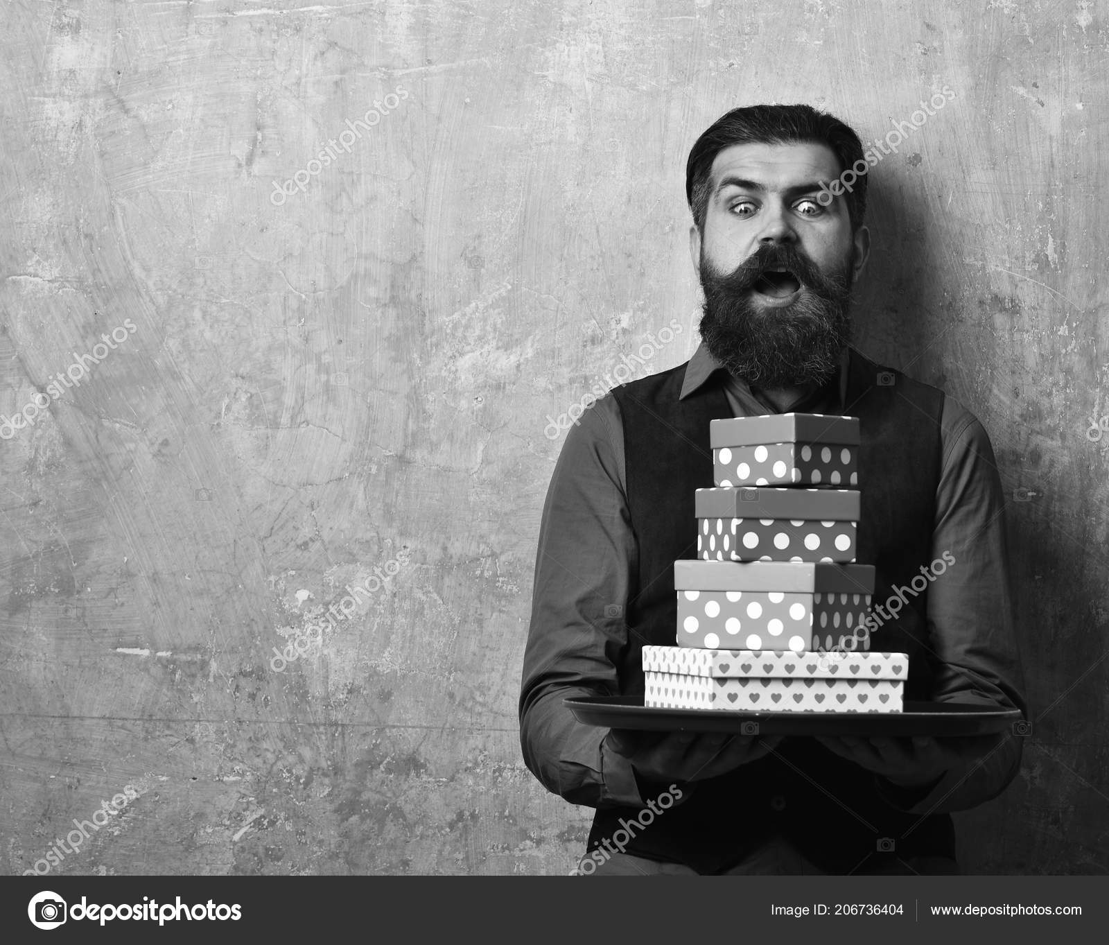 Businessman With Shocked Face Brings Gifts For Christmas Or Birthday Waiter Pink And Red Presents On Tray Man Beard Holds Boxes Beige Wall