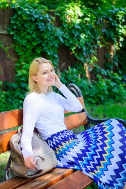 Ways to give yourself break and enjoy leisure. Peace and tranquility. Why you deserve break. Girl sit bench relaxing in shadow, green nature background. Woman blonde take break relaxing in park