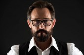 Fotografie Beard concept. Man in glasses with beard and moustache. Hipster with unshaven beard hair. Beard of formal cut