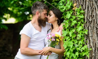 Gentle kiss. Man bearded hipster hugs gorgeous girlfriend. Couple in love going to kiss. Pleasant romantic kiss. Couple love romantic date nature park background. Love relations romantic feelings. stock vector
