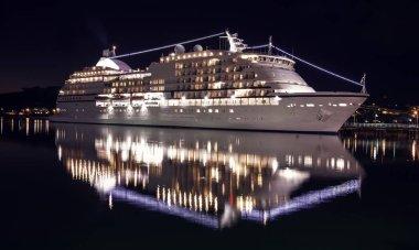 Big luxury cruise ship st night.Large luxury cruise ship on sea water at night with illuminated light docked at port of st.Johns, Antigua