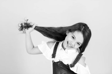 Beauty or hairdressing salon. black and white happy little girl