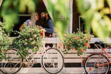 Lovers find place for secret dates. Blonde woman and bearded man happy to see each other.