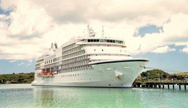 big cruise ship, white luxury yacht in sea port, Antigua