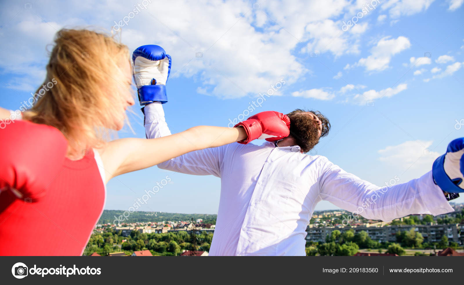 Let her win concept  Couple boxing gloves fight sky