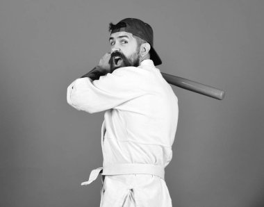 Athlete gets ready to fight. Man with beard in kimono