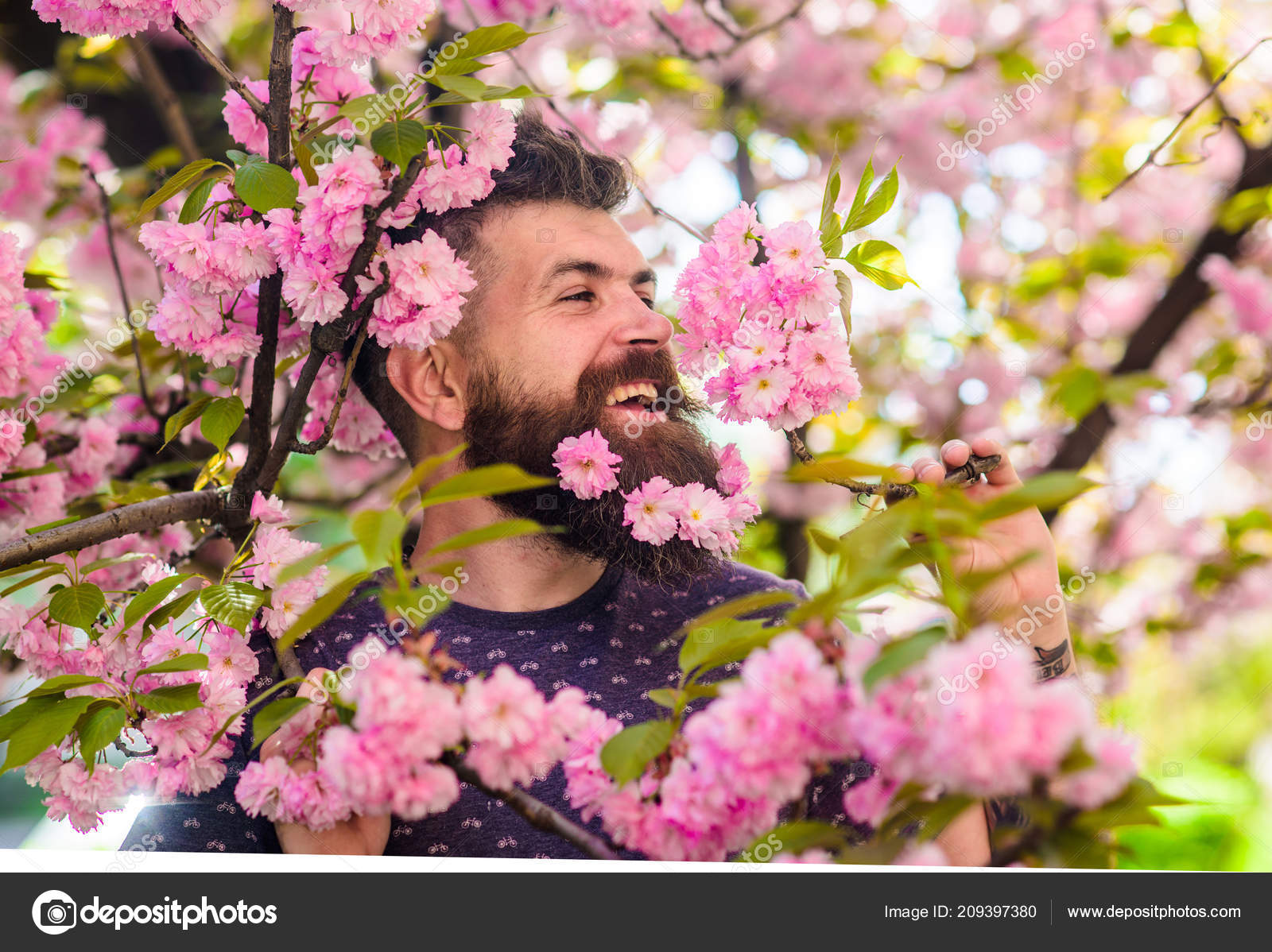 Man With Beard And Mustache On Happy Face Near Pink Flowers Hipster