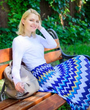 Why you deserve break. Girl sit bench relaxing in shadow, green nature background. Woman blonde take break relaxing in park. Feeling free and relaxed. Ways to give yourself break and enjoy leisure