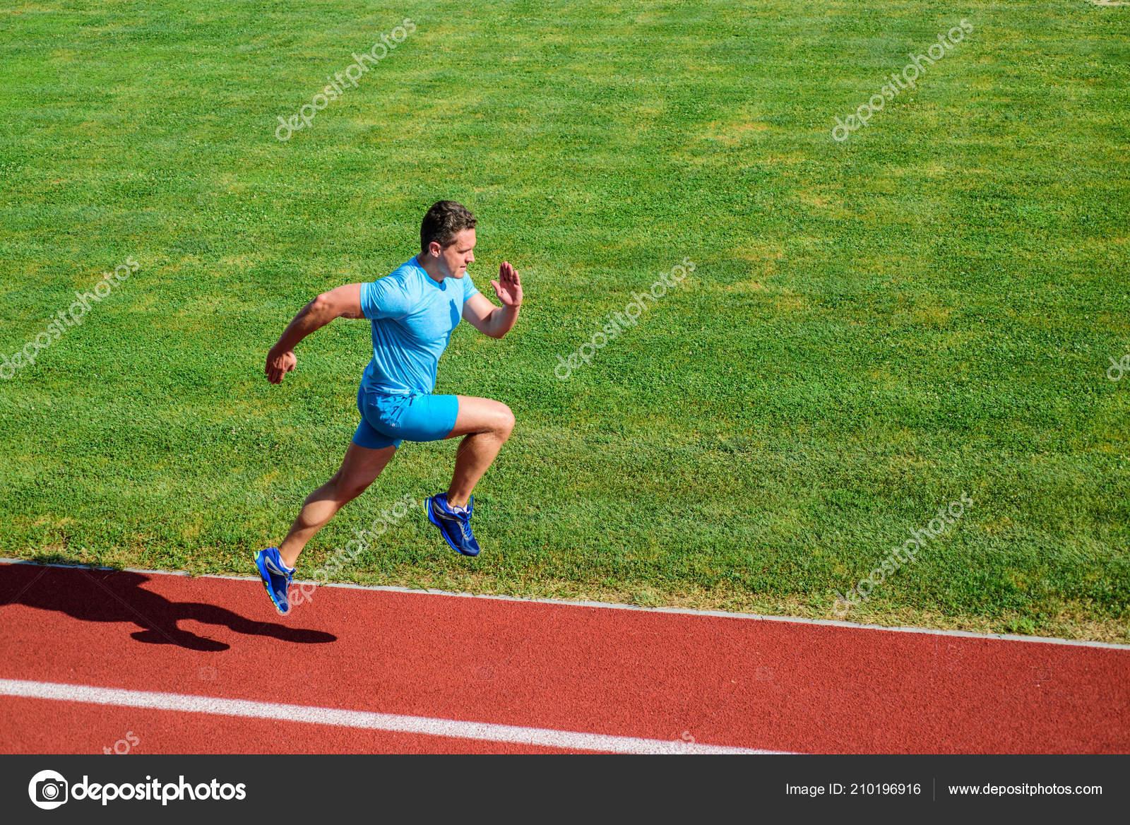 bdcada0eb3 Short distance running challenge. Boost speed. Athlete run track grass  background. Run into shape. Sprinter training at stadium track.