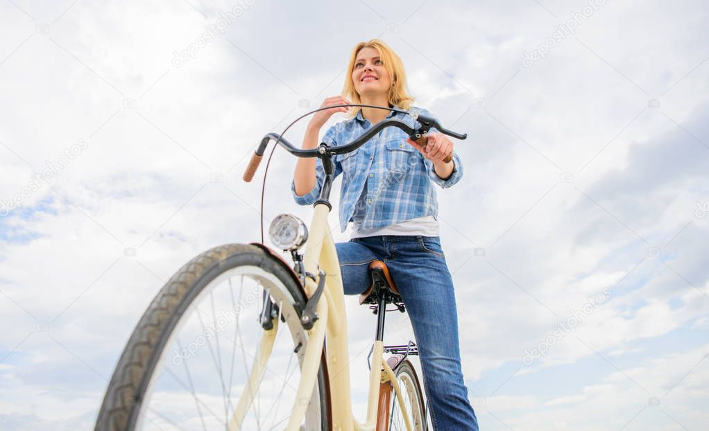 Girl rides bicycle sky background. How cycling changes your life and make you happy. Reasons to ride bicycle. Mental health benefits. Pedaling towards happiness. Woman feels happy while enjoy cycling