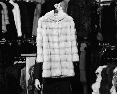 Beige mink fur coat on furry coats background.