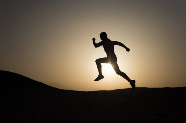 Never stop. Silhouette man motion running in front of sunset sky background. Future success depends on your efforts now. Daily motivation. Healthy lifestyle personal achievements goals and success