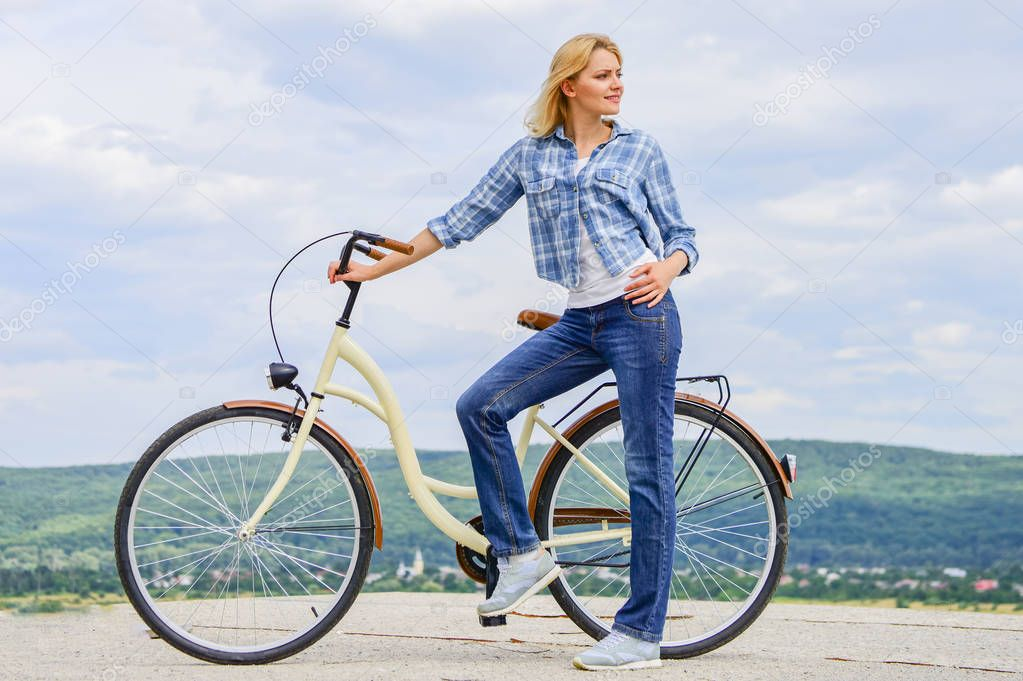 Benefits of cycling every day. Keep fit shape easy with regular cycling. Girl ride cruiser bicycle. Health benefits of regular cycling. Reasons to ride bike. Woman rides bicycle sky background