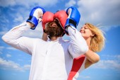 Fotografie Dexterous tricks play relations. Play and have fun. Tricks every woman needs to know. Girl smiling face covers male face boxing gloves. Break rules success. Tricky female. Relations game or struggle