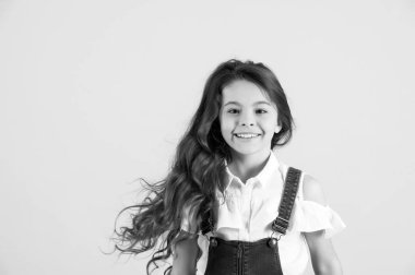 Haircare, hairstyle hairdresser. black and white happy little girl