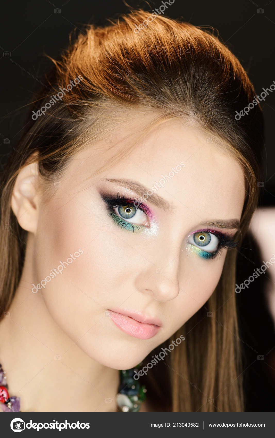 8ac10112a63 Girl with colourful makeup and long hair, selective focus. Lady with  seductive look and serious face on black background. Model wearing pink and  green ...