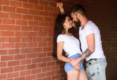No rules for them. Girl and hipster full of desire cuddling. Couple in love full of desire brick wall background. Couple find place to be alone. Couple enjoy intimacy without witnesses public place