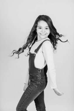 Child happy smiling with flowing long brunette hair, beauty