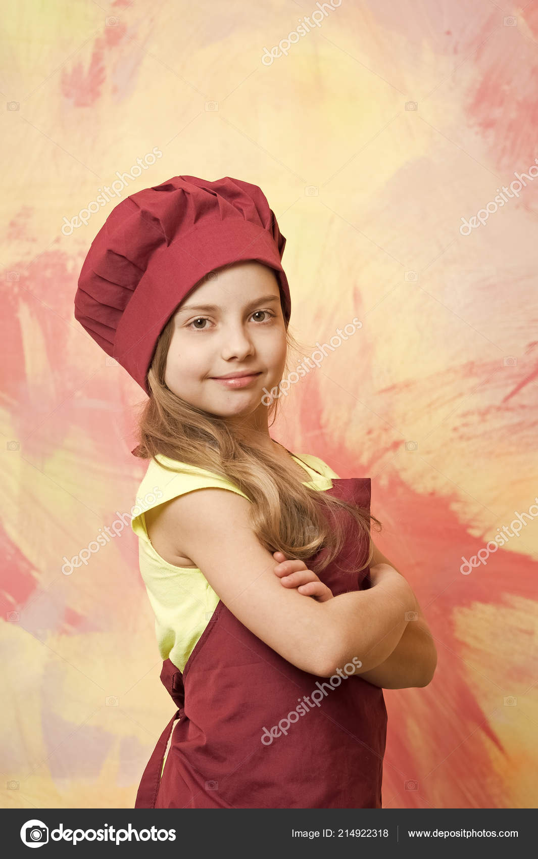 8b189bb15 Small baby girl or cute child with happy face in red chef hat and cook apron  on colorful abstract background — Photo by ...