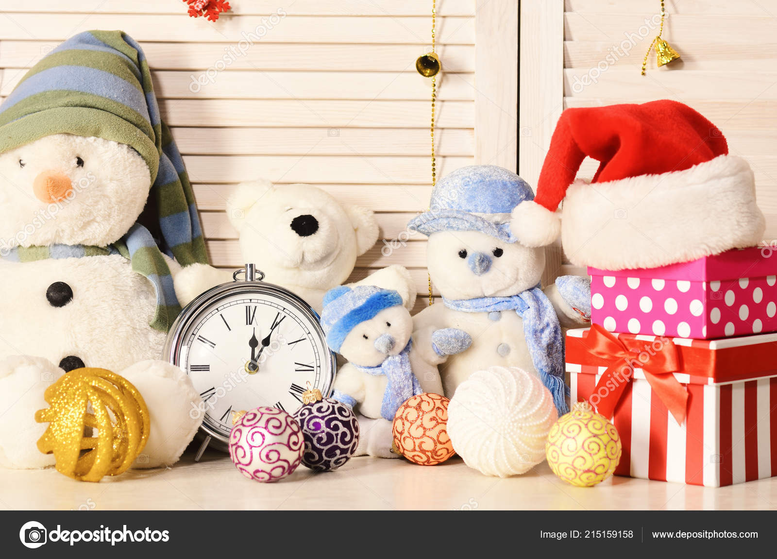 Toys placed on bureau on wooden wall background u2014 stock photo